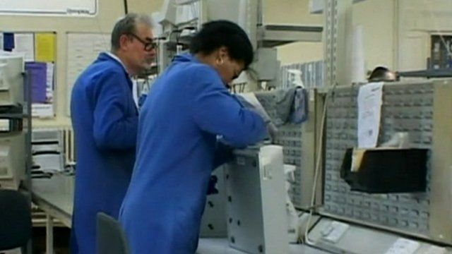 People in Remploy factory refurbishing computers