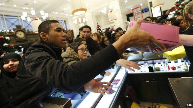 Shoppers crowd inside the Selfridges in London