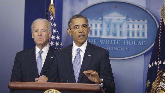 President Barack Obama, with Vice-President Joe Biden at his side