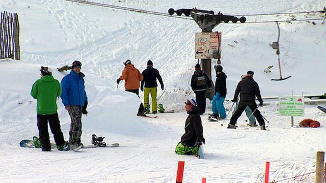 Skiers and snowboarders on a slope