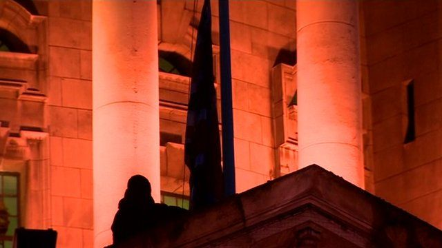 Union flag being raised at Belfast City Hall