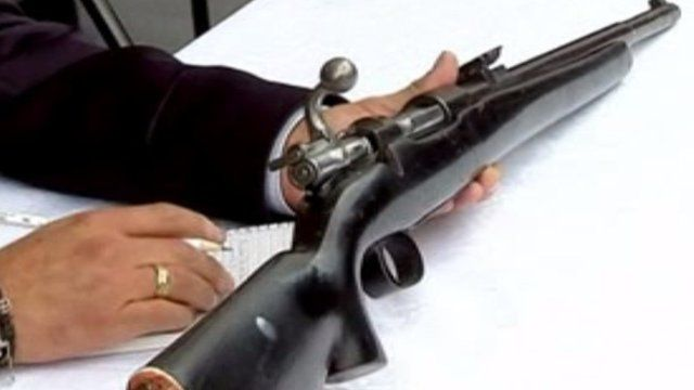 A gun being exchanged in Mexico