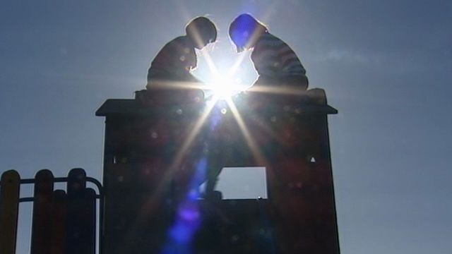 Children at play on a climbing frame
