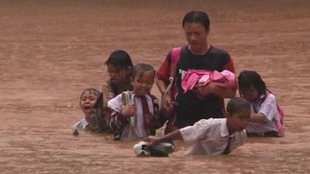 People battling through floodwaters