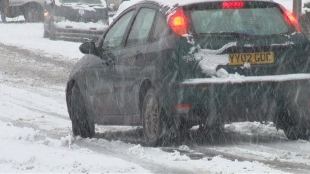 Car driving in snow