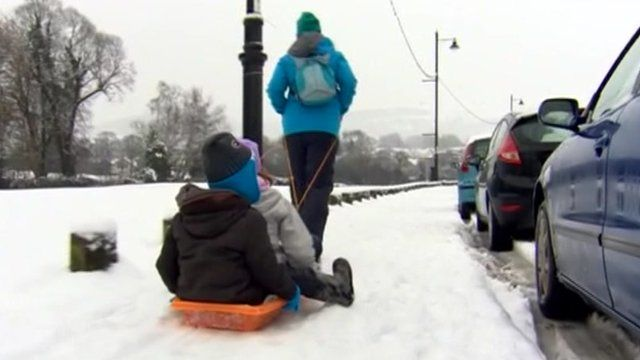 Kids being pulled on a sledge
