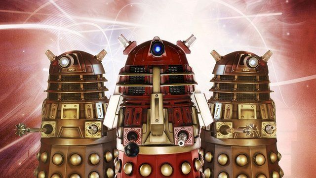 Two Daleks on either side of the Supreme Dalek