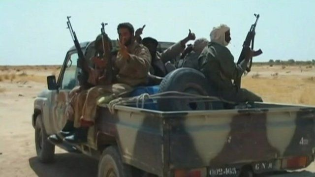 Armed Malian rebels on a truck
