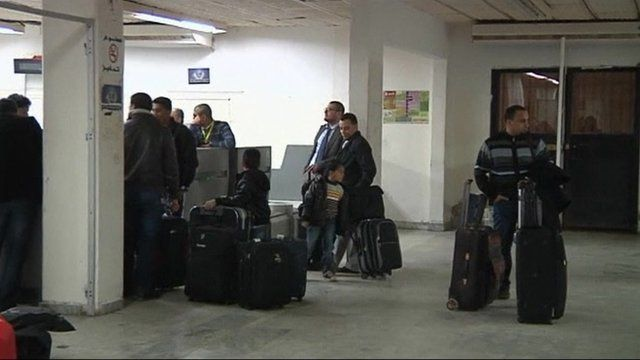 People with suitcases at Benghazi airport