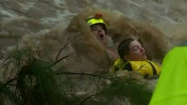 Teenager being rescued from floodwaters in Queensland