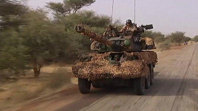 A tank drives through Mali