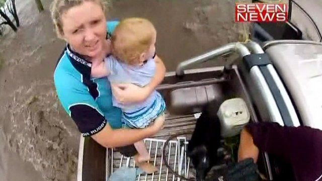 Helicopter footage shows toddler being rescued from Queensland floods
