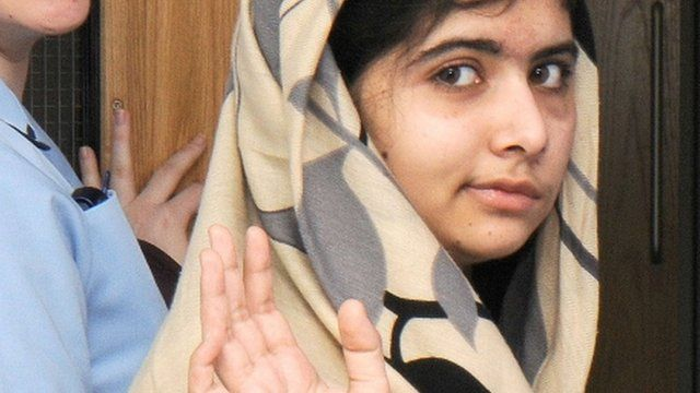 Malala Yousafzai waving as she is discharged from the Queen Elizabeth Hospital in Birmingham