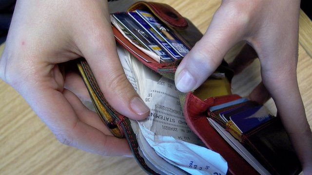 wallet containing receipts and cards