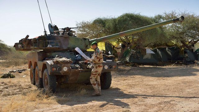 A French legionnaire works next to a Sagaie at Timbuktu airport after French-led forces recaptured the northern Malian desert city