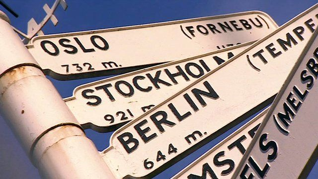A sign displaying the distances to international cities
