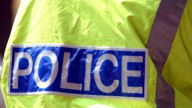 A policeman wearing a distinctive fluorescent jacket