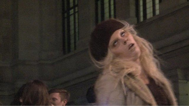 Woman pretending to be a zombie.