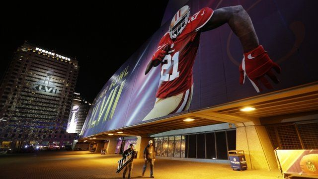 Workers continue preparations outside the Mercedes Benz Superdome