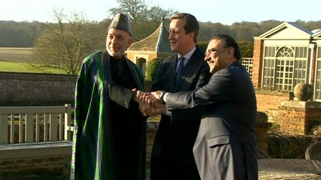 Karzai, Cameron and Zardari holding hands
