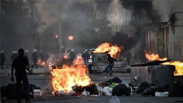 Protesters clash with security forces in the village of Sanabis, west of the capital Manama.