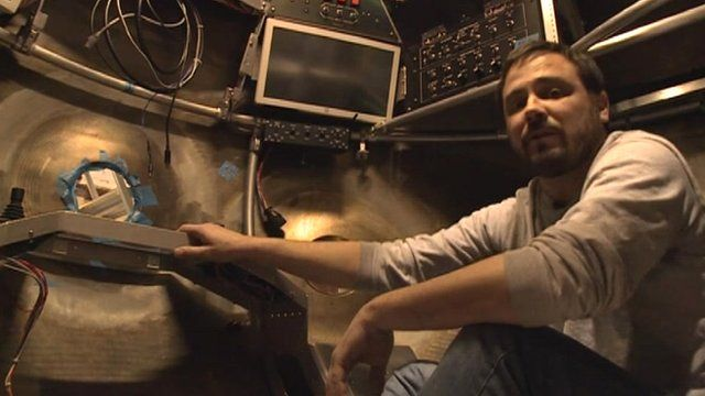 Alvin Pilot Mike Skowronski inside the submersible