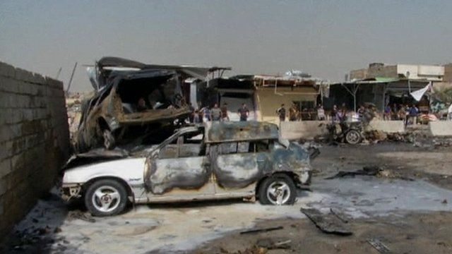 Burnt-out cars, one on top of the other, in Baghdad