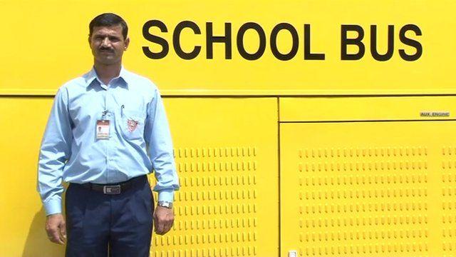 Gyanendra Singh in front of his school bus