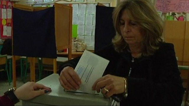A woman votes in Cyprus
