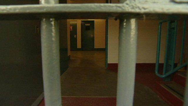 Prison cell through bars