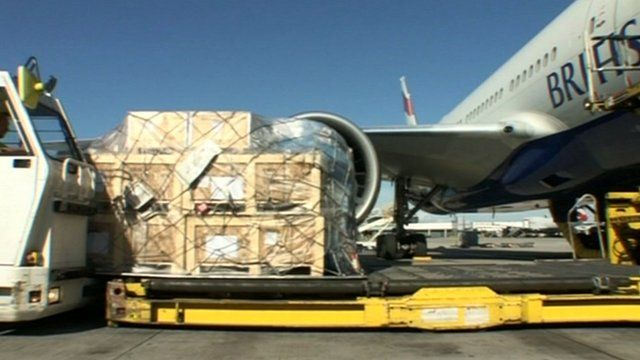 Aid boxes are loaded onto a plane
