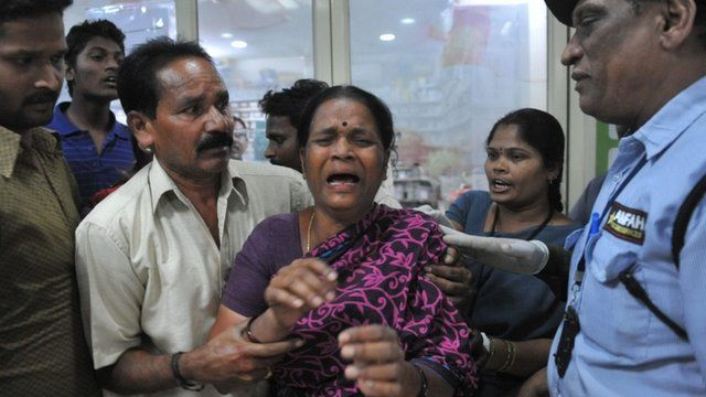 A relative reacts at the Omini hospital Kothapet following bomb blasts in Hyderabad