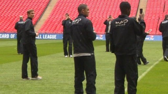 Players on Wembley pitch