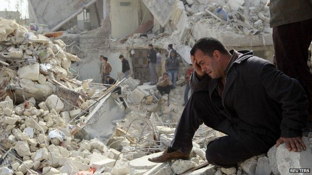 A man cries at a site hit by rockets in eastern districts of Aleppo, Syria