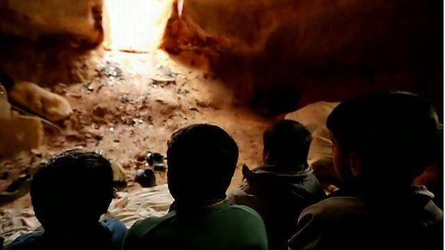Children in underground tunnel