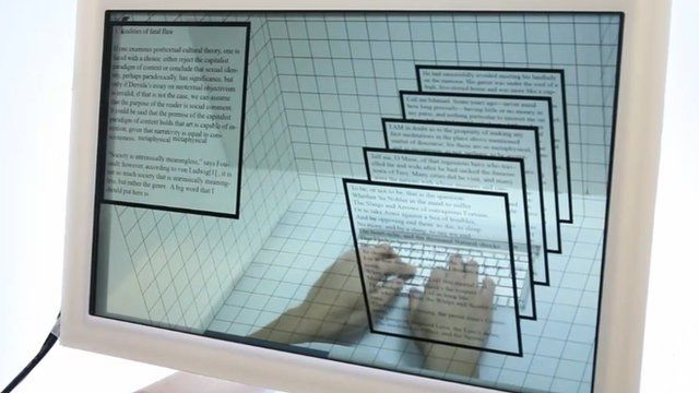 A transparent computer screen with a man's hands behind it. In the foreground, computer windows float above his hands.