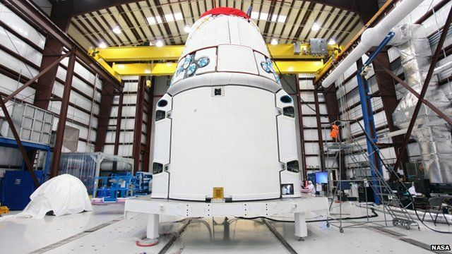 The Dragon spacecraft inside a processing hangar at Cape Canaveral Air Force Station in Cape Canaveral