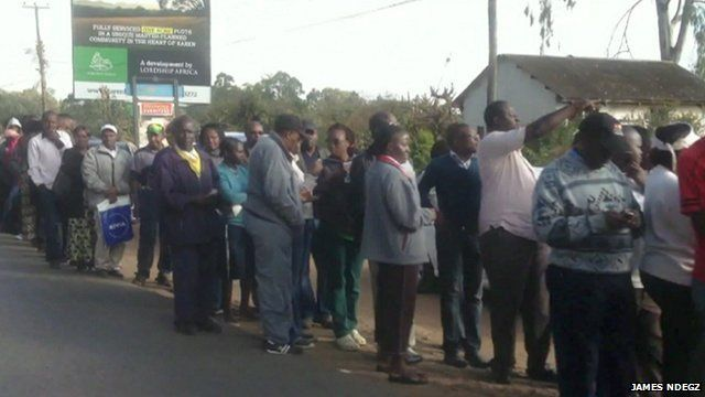 People queuing outside a polling station