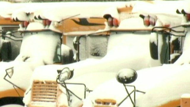 US school buses covered in snow