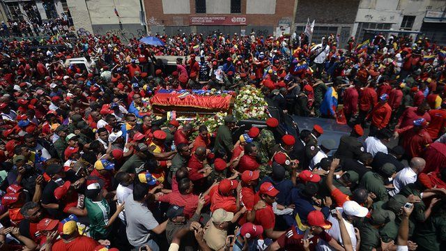 The hearse carrying President Chavez's coffin passes through packed streets