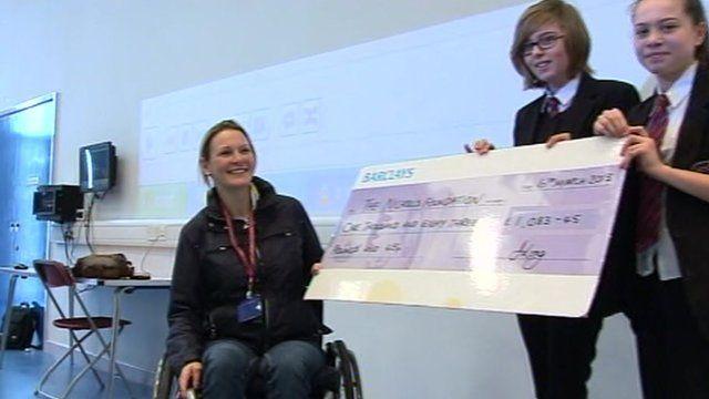 Claire Lomas receiving cheque