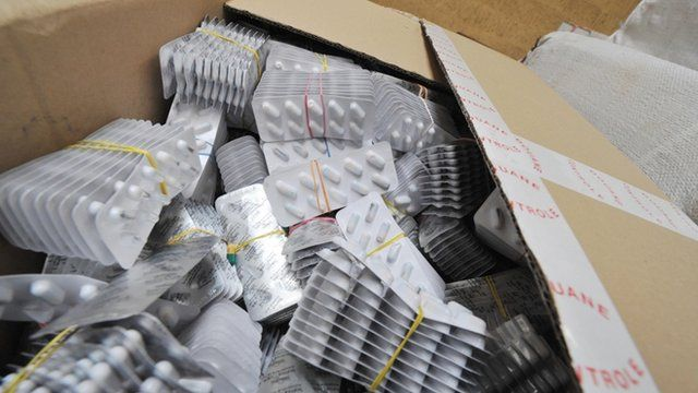 A box of seized counterfeit medical pills found at customs