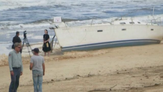 Camera crews at the looted yacht