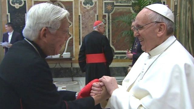 Pope Francis greets the cardinals