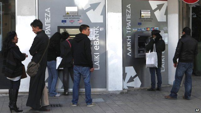 People waiting to use ATMs in Nicosia