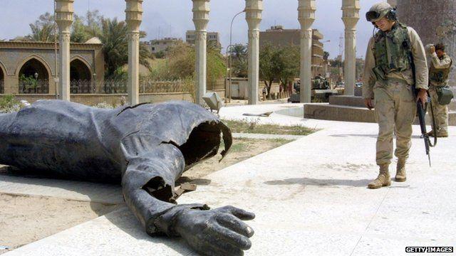 Fallen statue of Saddam Hussein