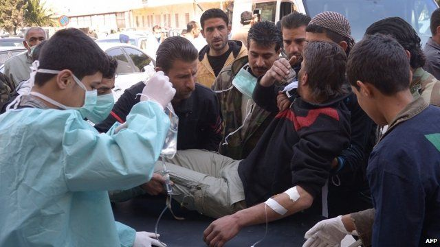 Man on stretcher purportedly after chemical attack