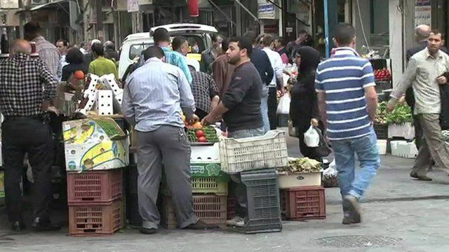 Syrians shopping in a Damascus market