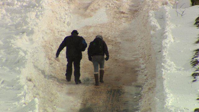 Walking up snowy hill