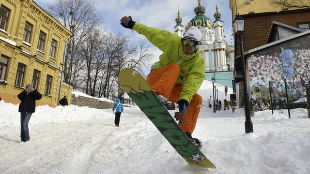Man snowboarding on the road